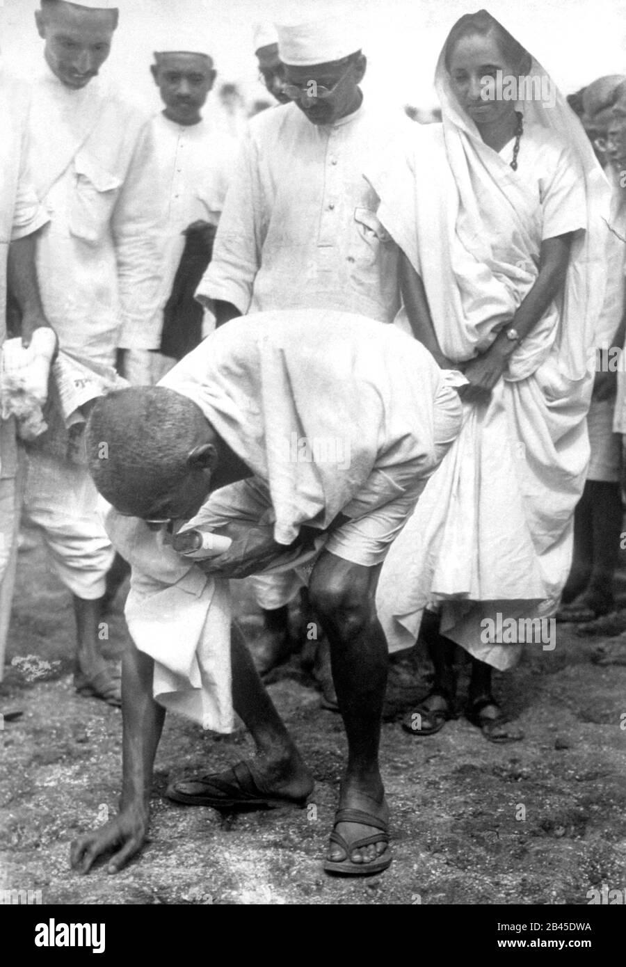mahatma gandhi breaking the salt law in dandi at gujarat, India, Asia Stock Photo