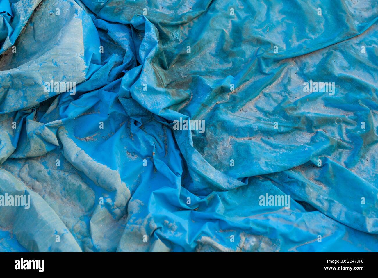 Closeup shot of a wrinkled blue plastic film texture Stock Photo