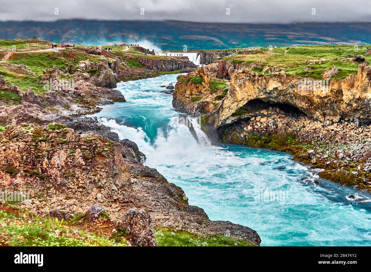 The Goðafoss is one of the most spectacular waterfalls in Iceland. It is located in the Bárðardalur district of North-Central Iceland at the beginning of the Sprengisandur highland road. The water of the river Skjálfandafljót falls from a height of 12 meters over a width of 30 meters. Stock Photo