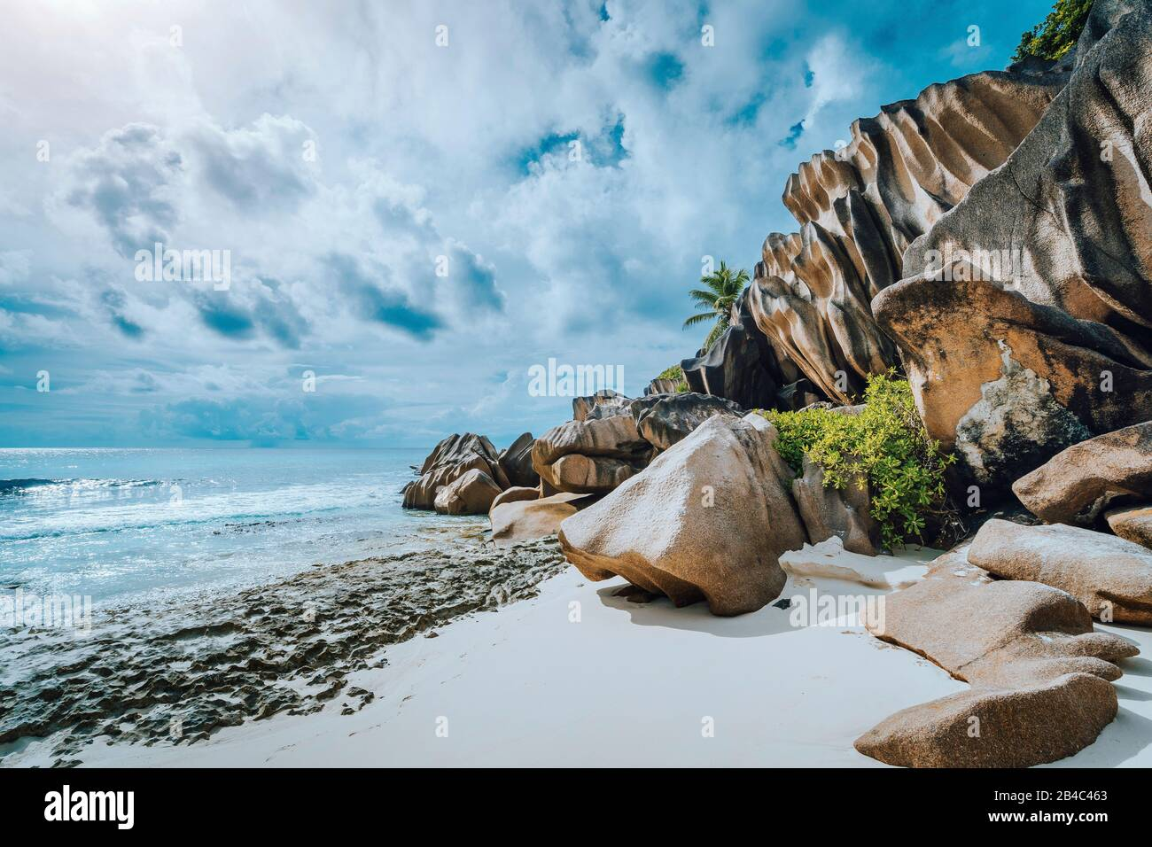 Picturesque granite boulders formation on tropical white sand beach Grand Anse, La Digue island, Seychelles. Stock Photo