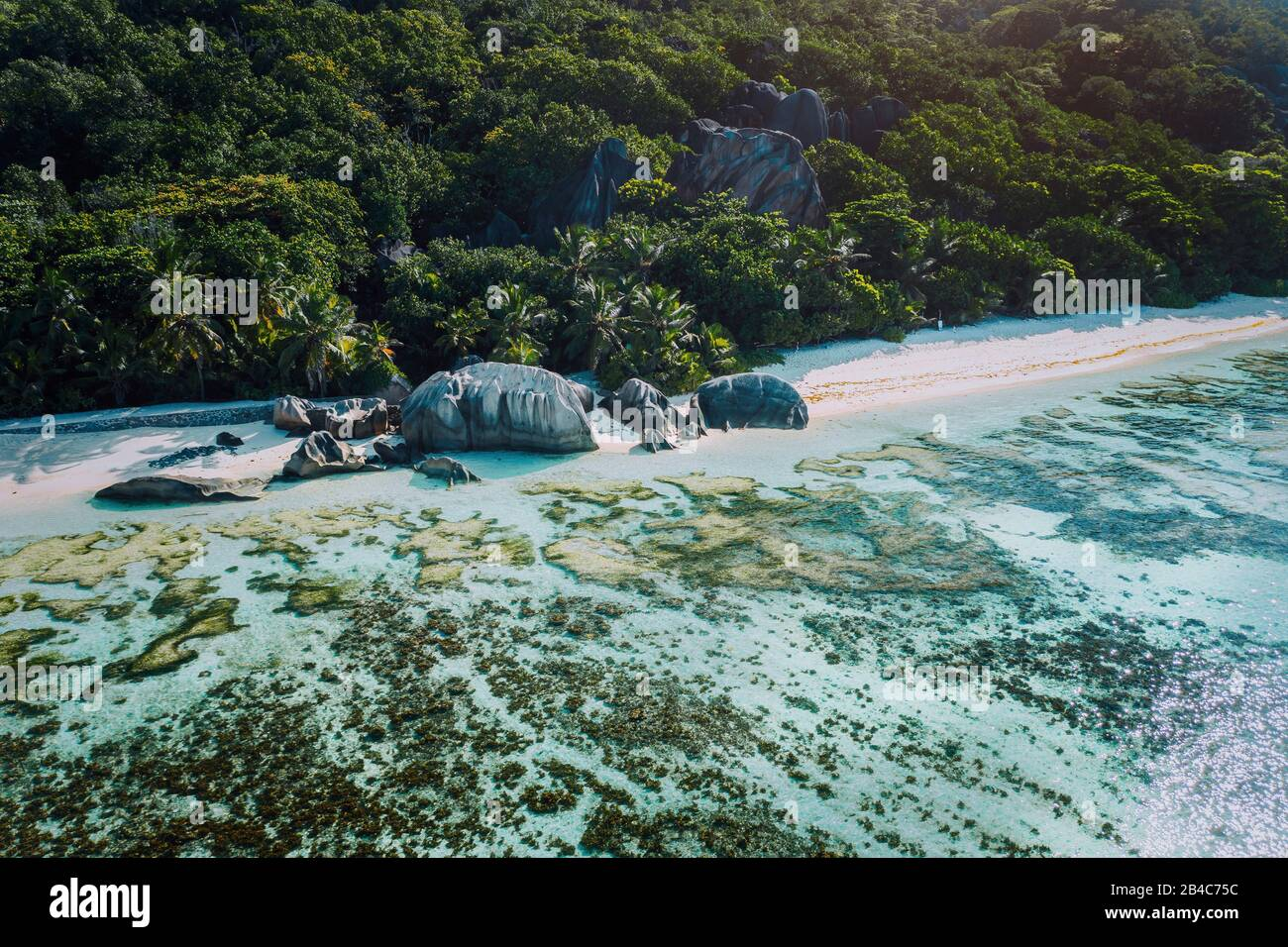 Aerial view of bay with shallow water on early morning of unique Anse Source D'Argent tropical beach, La Digue Seychelles. Luxury exotic travel concept. Stock Photo