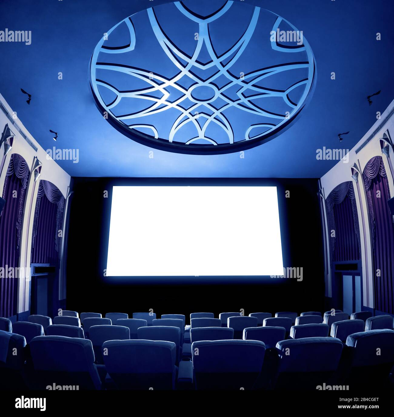Cinema Theater Screen In Front Of Seat Rows In Movie Theater Showing White Screen Projected From Cinematograph The Cinema Theater Is Decorated In Cla Stock Photo Alamy