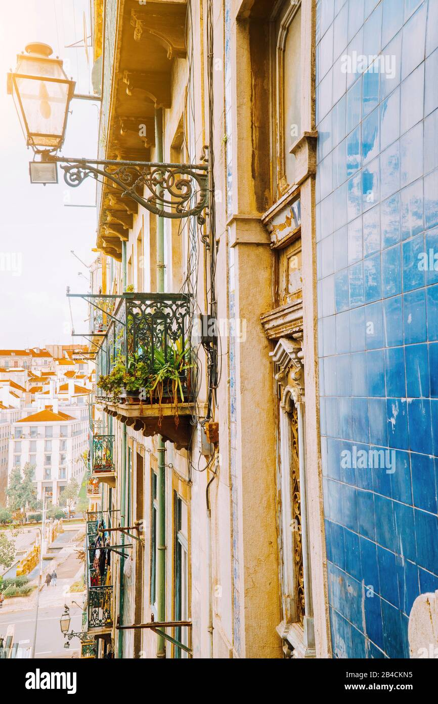 Traditional facade front of portuguese buildings with balconys and lamps. Old charming street in Lisbon, Lisboa, Lissabon, Portugal, Europe Stock Photo