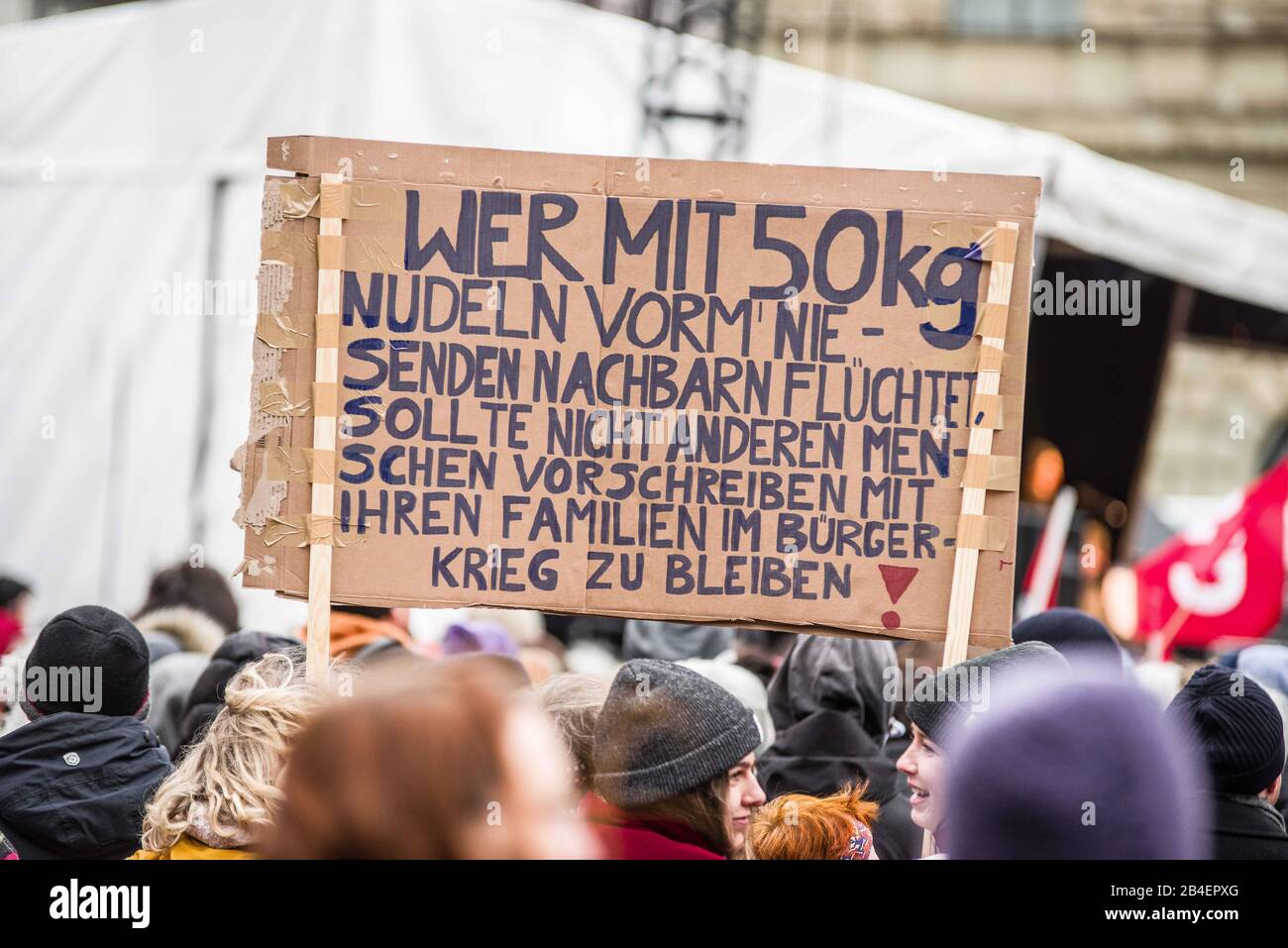 """Munich, Bavaria, Germany. 6th Mar, 2020. A sign criticizing Germany for ''Hamster Shopping'' as a response to the Coronavirus, leaving pasta and toilet paper shelves throughout the country empty. As a response to the politics of hate and the terror attack in Hanau many attribute to the Alternative for Germany (AfD) party and the CSU of Bavaria, the Bellevue di Monaco and the Bayerisches Fluechtlingsrat (Bavarian Refugee Center) organized the """"Just Don't Do It"""""""" demonstration at Max Joseph Platz to oppose hate and right-wing terrorism in Germany. Counting the latest developments, Germany Stock Photo"""