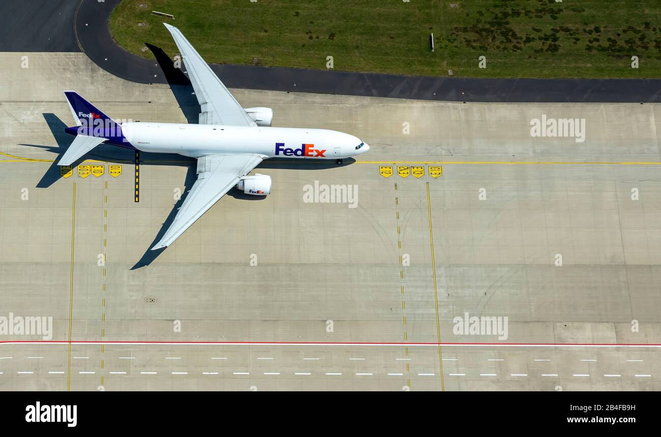 Aerial view of the airport Cologne / Bonn 'Konrad Adenauer' with FeDex cargo plane on the apron, international airport in the southeastern city area in Cologne-Grengel and to a small part on Troisdorf area in Cologne in the Rhineland in the state of North Rhine-Westphalia, Germany, Stock Photo