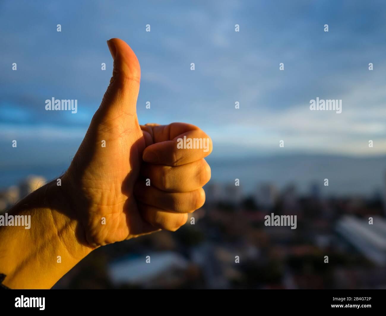 Thumb-up finger Stock Photo