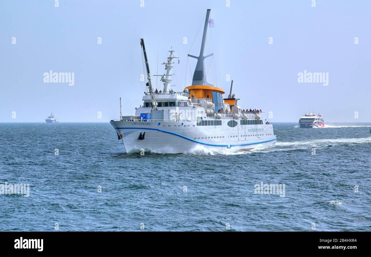 Sea-bathing ship Helgoland and catamaran on the way to the island Helgoland, Helgoland bay, German bay, North Sea island, North Sea, Schleswig-Holstein, Germany Stock Photo