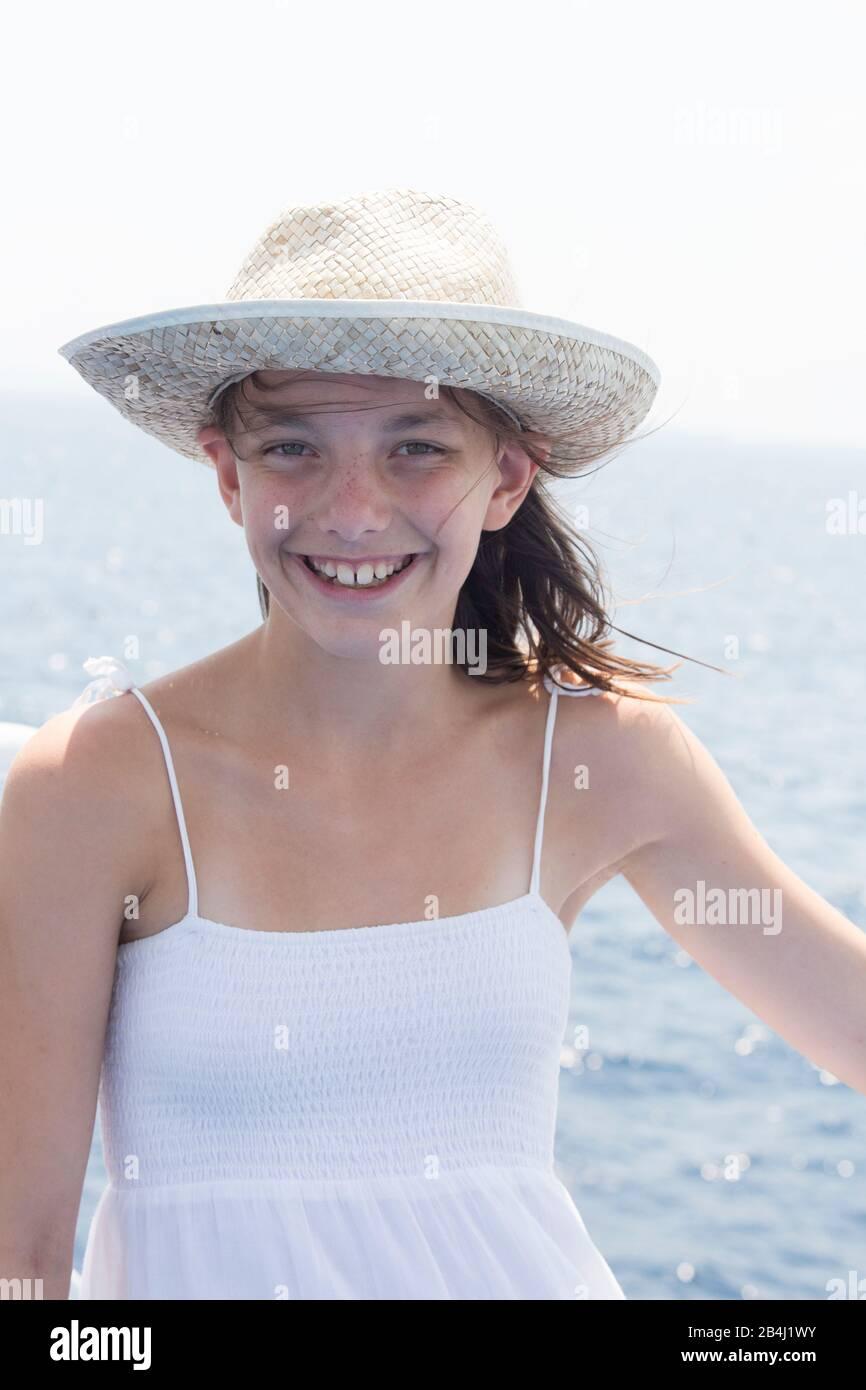 girl with sunhat, smile, half portrait Stock Photo