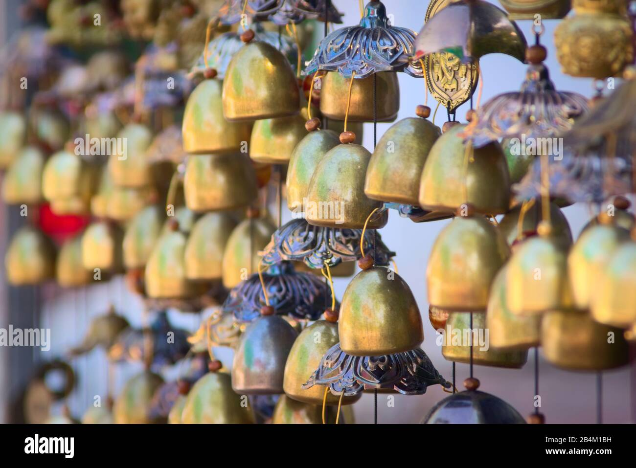 Traditional Lao chime bells at a stand in Luang Prabang, Laos. Stock Photo