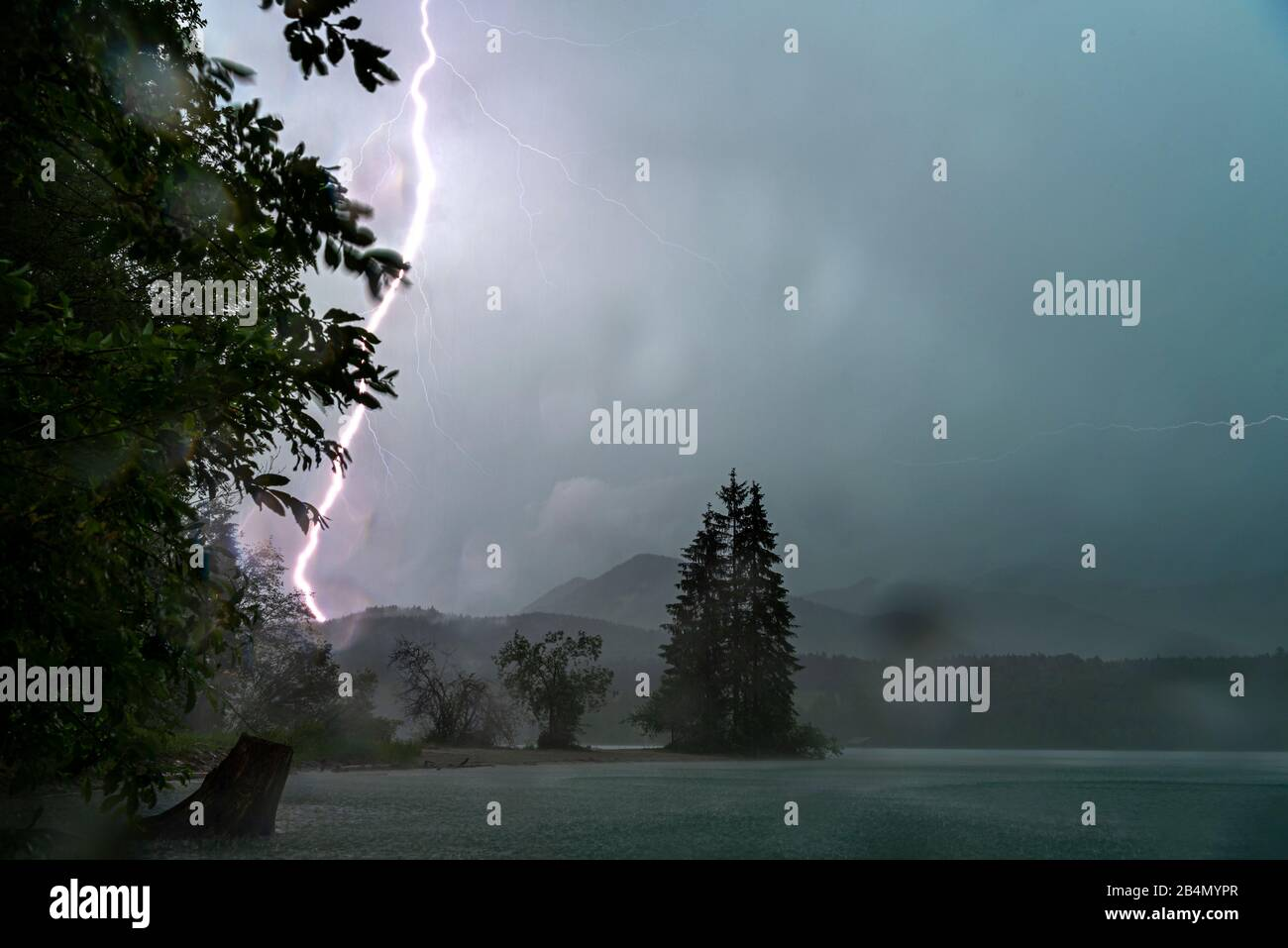 Thunderstorm on the banks of the Walchensee during severe weather Stock Photo