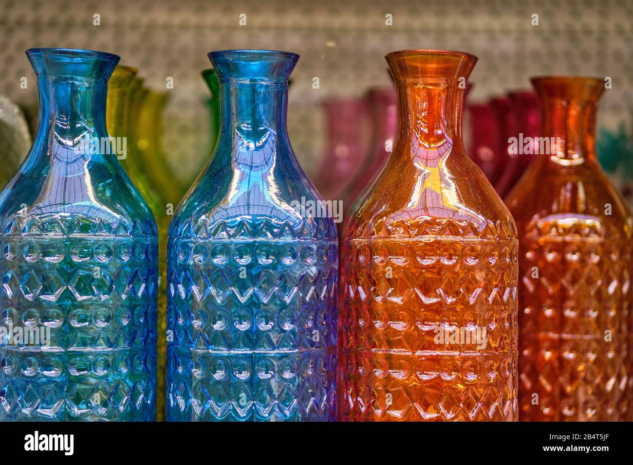 Multicolored Glass Decorative Bottles In A Store Close Up Stock Photo Alamy