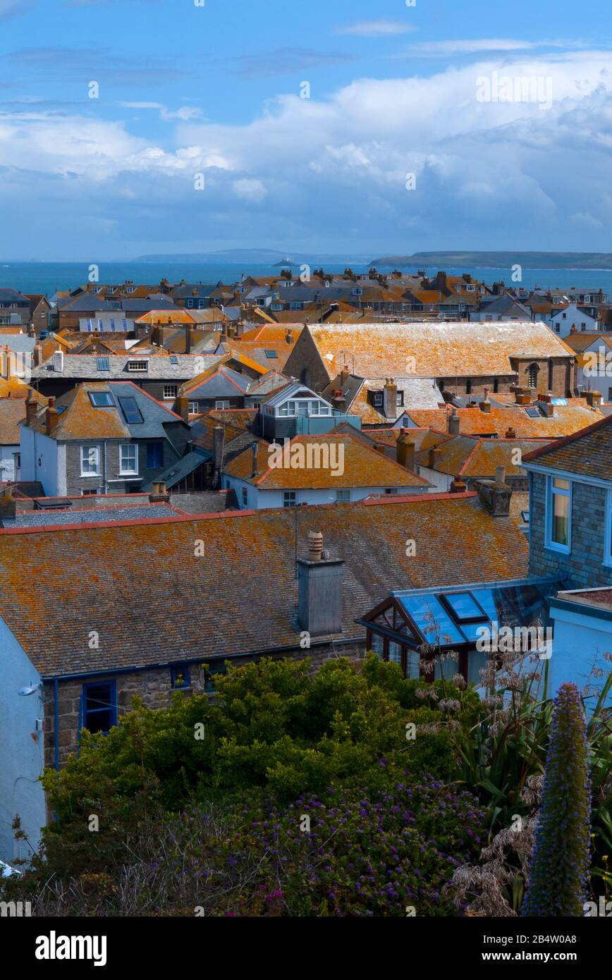 St Ives rooftops looking towards Godrevy lighthouse, Cornwall, United Kingdom Stock Photo