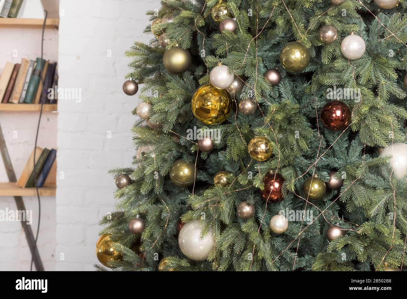Christmas Tree With Shiny White Gold And Bronze Baubles In Living Room Branches Of Christmas Trees With Bronze Brown Toys And Garland On A Blurred Stock Photo Alamy