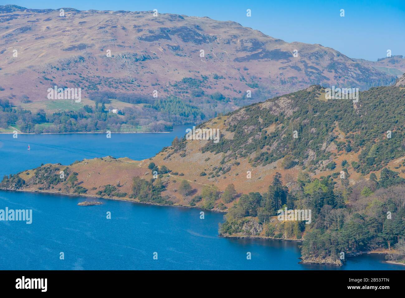 View of the southern part of Ullswater from Keldas, a hill above Glenridding and Patterdale in the Lake District on a clear April afternoon. Stock Photo