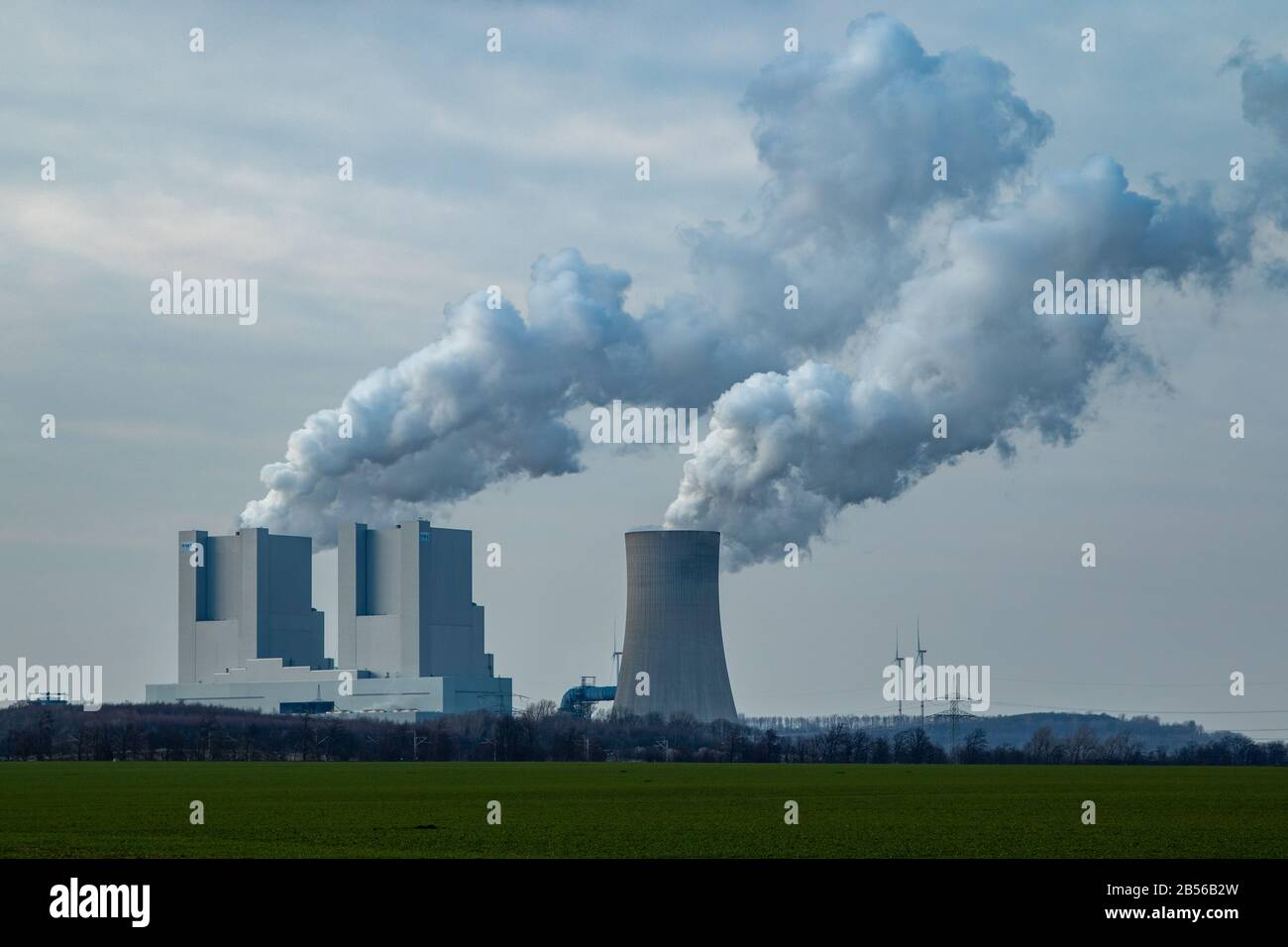 Rommerskirchen NRW, Germany, 07 03 2020, RWE coal fired power plangt Neurath, chimney with exhaust gases, cloudy sky Stock Photo