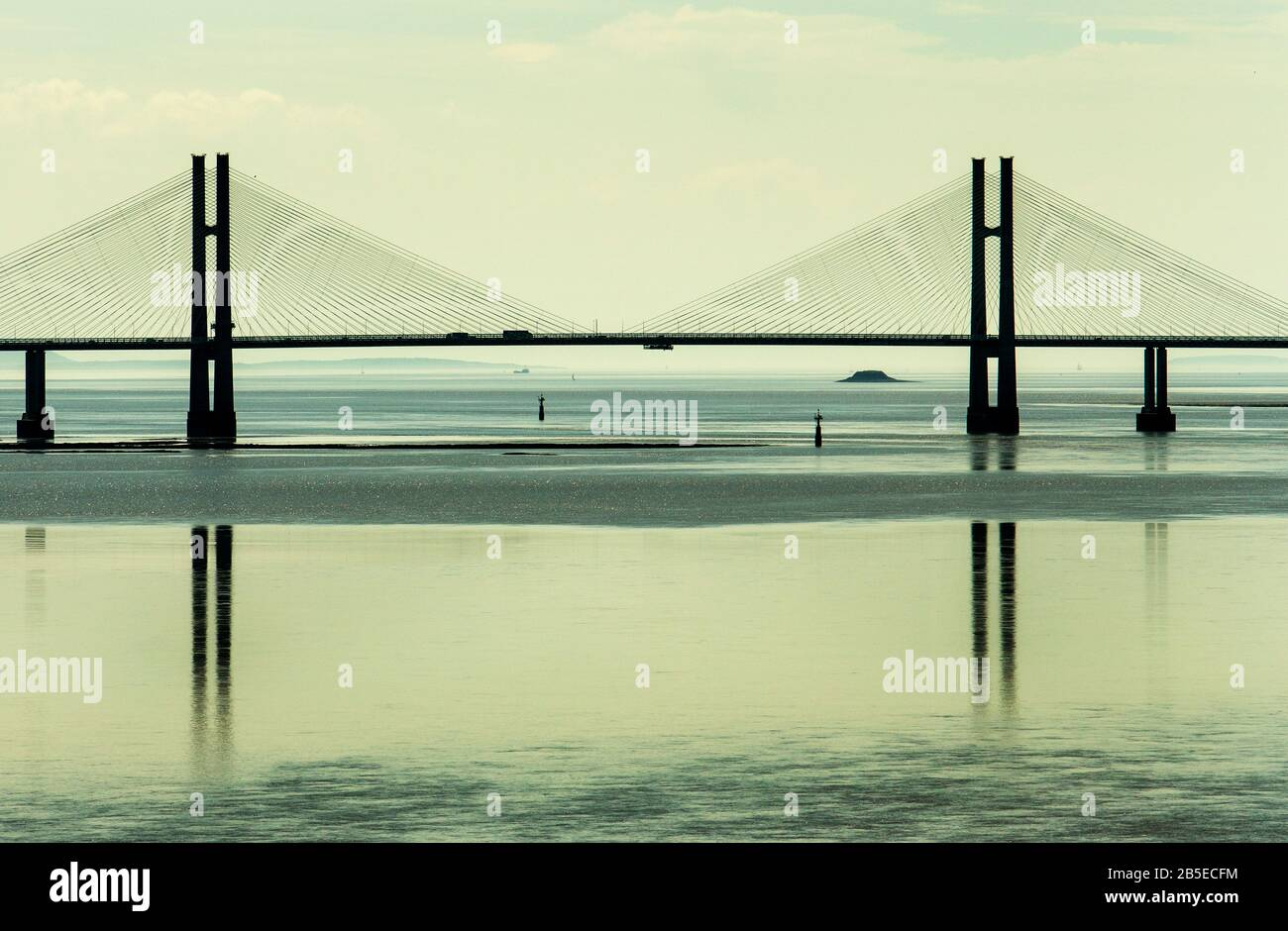 The Prince of Wales Bridge second (new) Severn suspension bridge crossing the estuary of the River Severn bridge reflected in the water, England UK Stock Photo