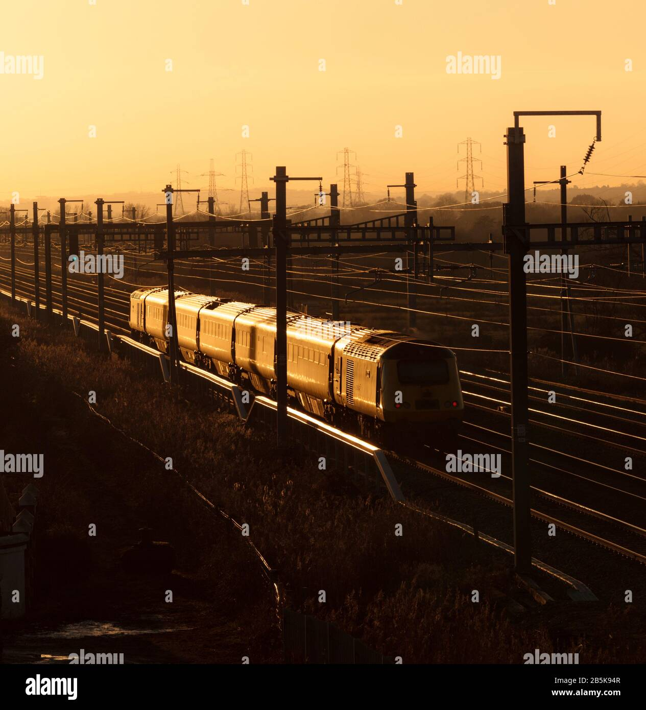 The Network Rail New Measurement train on the south Wales main line glinting in the setting sun Stock Photo