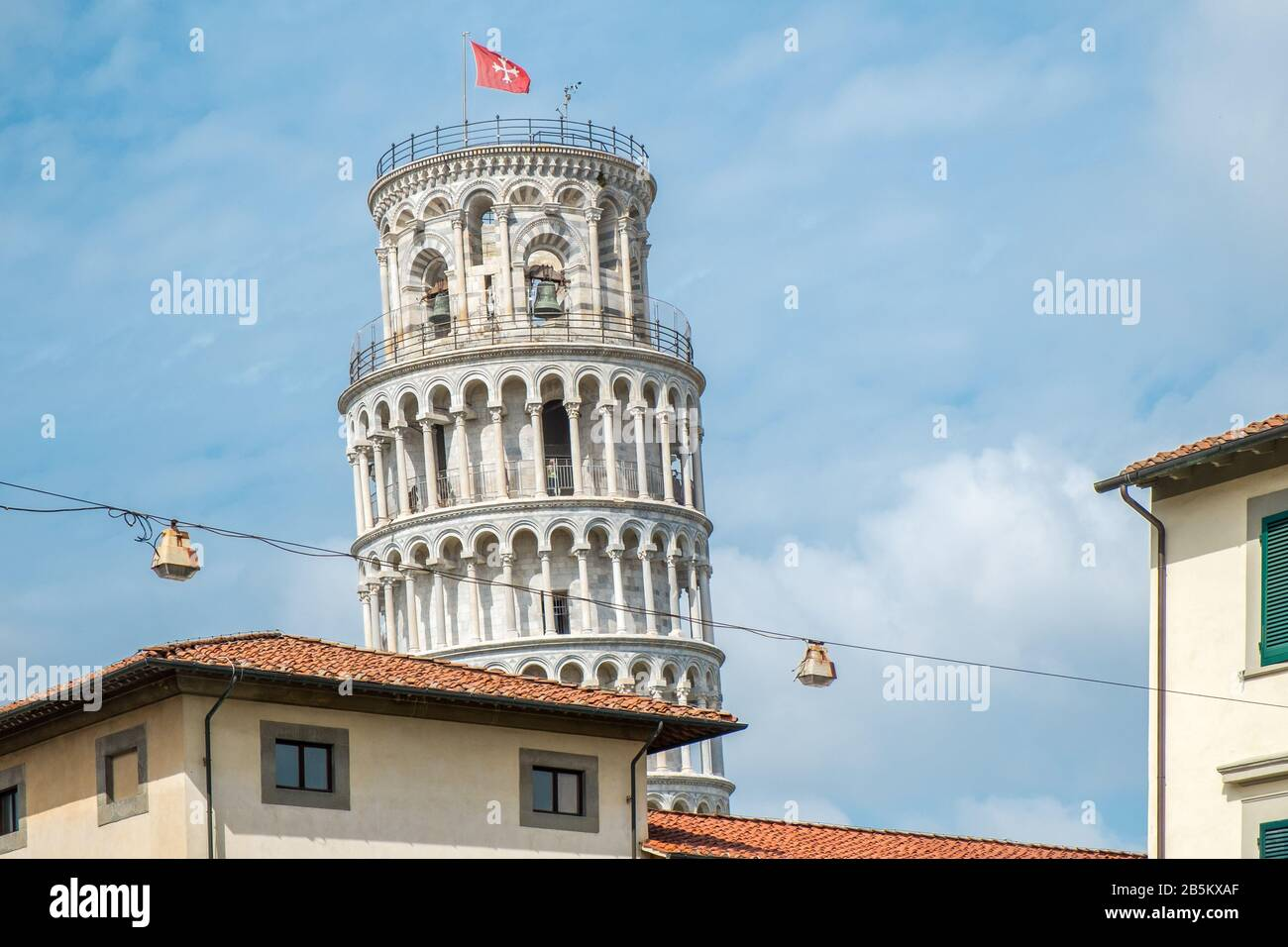 The world famous leaning tower in Pisa, Tuscany.  The construction of the tower was begun in the 12th century. Stock Photo