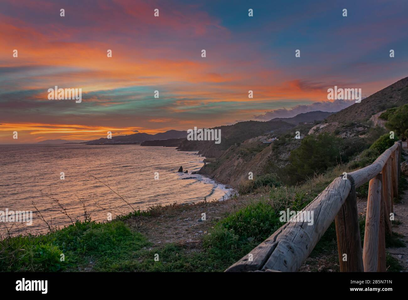 Landscape of a rocky coast with sunset colors Stock Photo