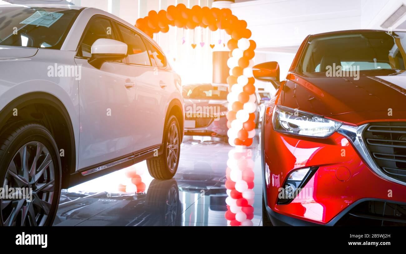 Front View Of Red And White Suv Car New And Shiny Luxury Suv Car Parked In Modern Showroom For Sale Car Dealership Office Automobile Retail Shop Stock Photo Alamy