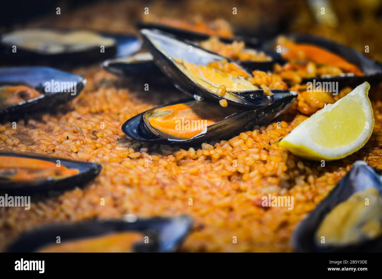 spanish paella dish with fresh seafood & vegetables Stock Photo