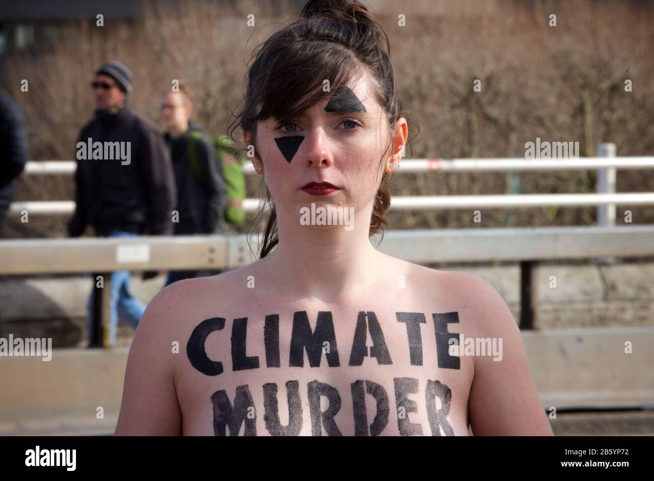 """London, UK. 08th Mar, 2020. 08.03.20 - A group of 31 women formed a chain across Waterloo Bridge to """"highlight the disproportionate impact of the climate and ecological emergency on women"""" Credit: Gareth Morris/Alamy Live News Stock Photo"""