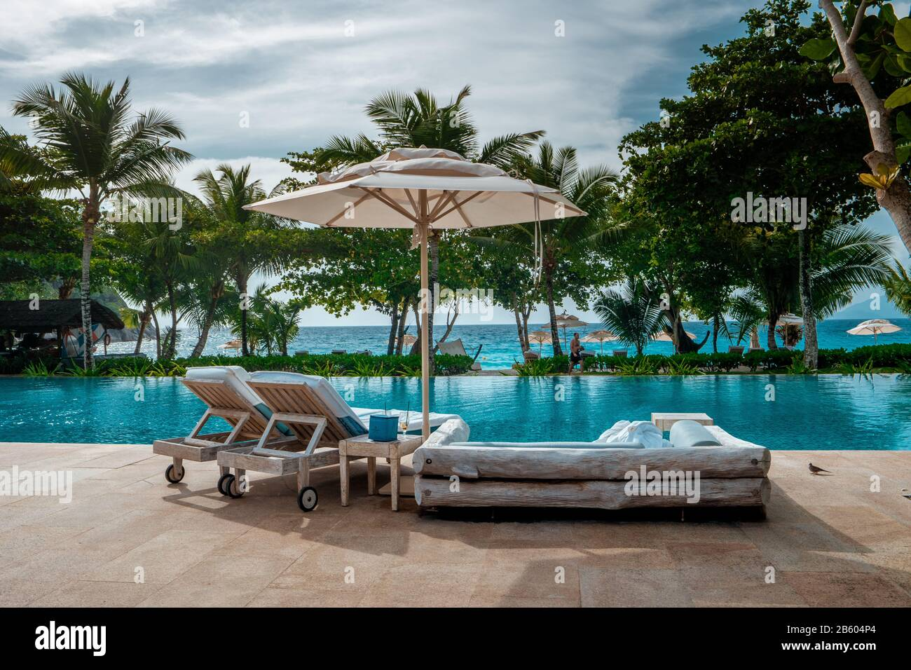 Mahe Seychelles Luxury Swimming Pool With Chairs At The Four