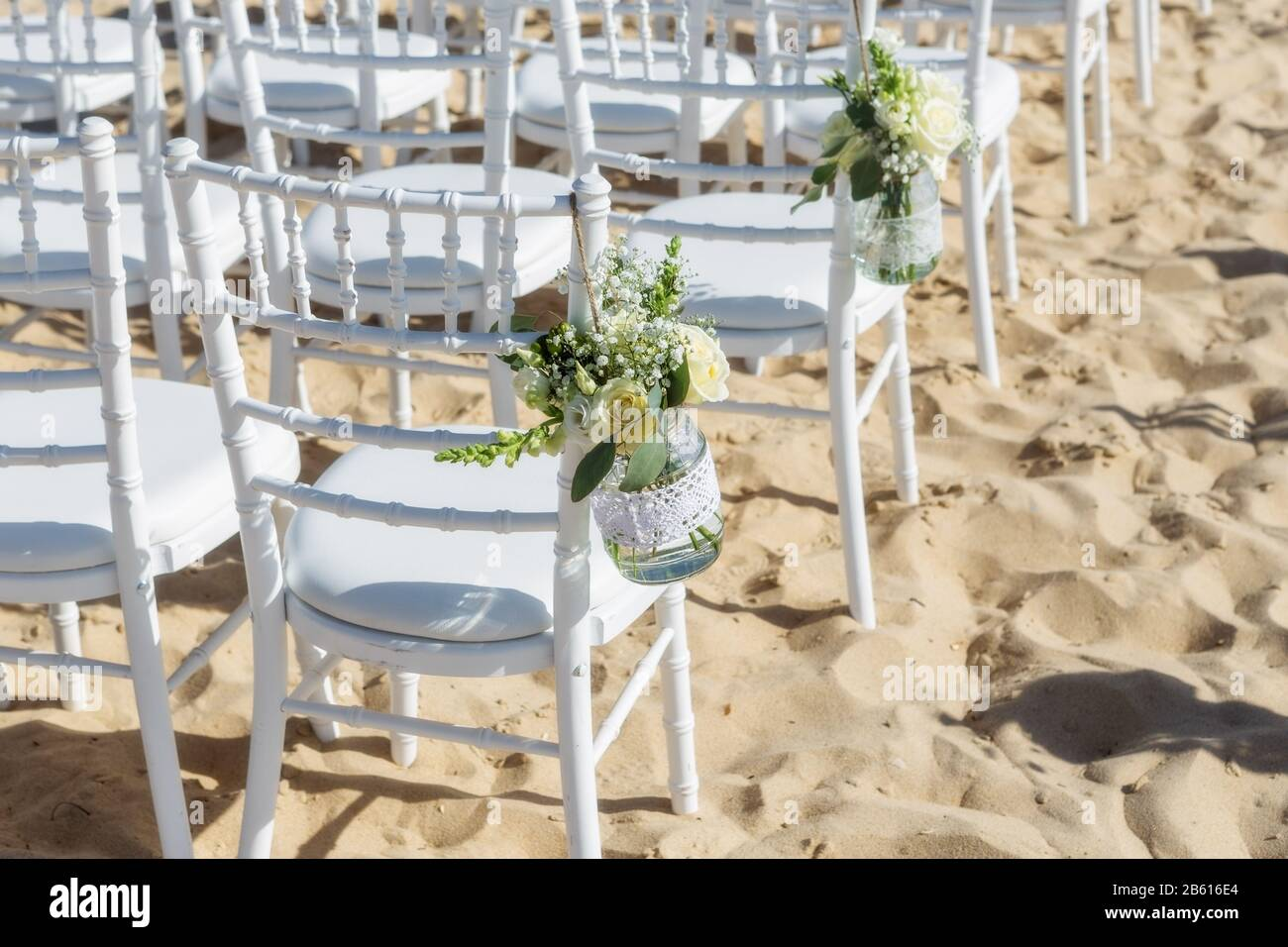 Decoration Flowers For A Wedding Ceremony Chairs For Guests Stock Photo Alamy