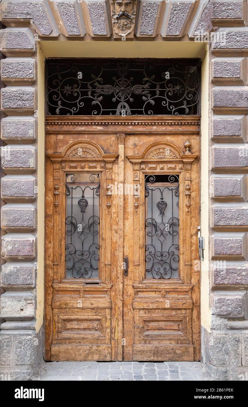 Vintage Wooden Double Door With Framed Door Panels And Antique Ornate Metal Lattices Stock Photo Alamy