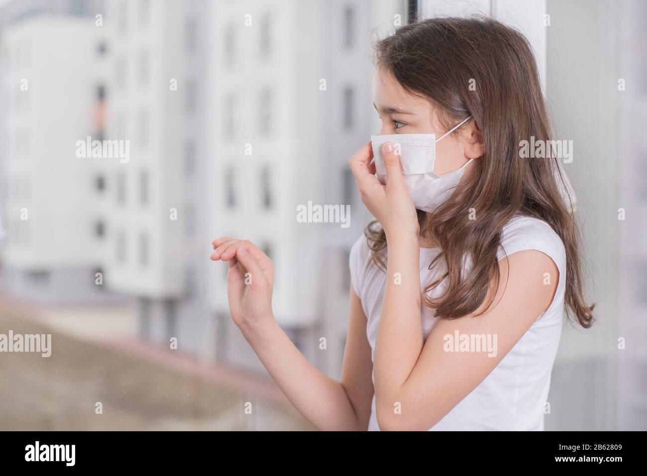Coronovirus Quarantine Concept.Little girl wearing mask for ...