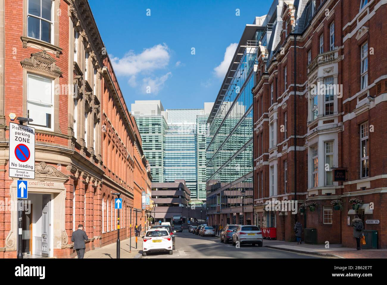 Looking down Edmund Street lined with Victorian buildings towards modern Snowhill in Birmingham's business district Stock Photo