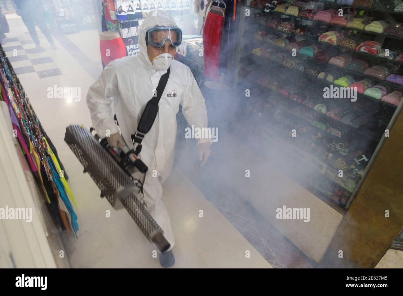 Tehran, Iran. 6th Mar, 2020. Firefighter teams with protective suits disinfect the Tajrish Bazaar shopping center as a precaution to the coronavirus (Covid-19) in Tehran. Iranian officials canceled Friday prayer for the second week due to concerns over the spread of coronavirus and COVID-19. According to the last report by the Ministry of Health, there are 4,747 COVID-19 cases in Iran. 147 people have died so far. A Health Ministry spokesman warned authorities could use unspecified 'force' to halt travel between major cities. Credit: Rouzbeh Fouladi/ZUMA Wire/Alamy Live News Stock Photo