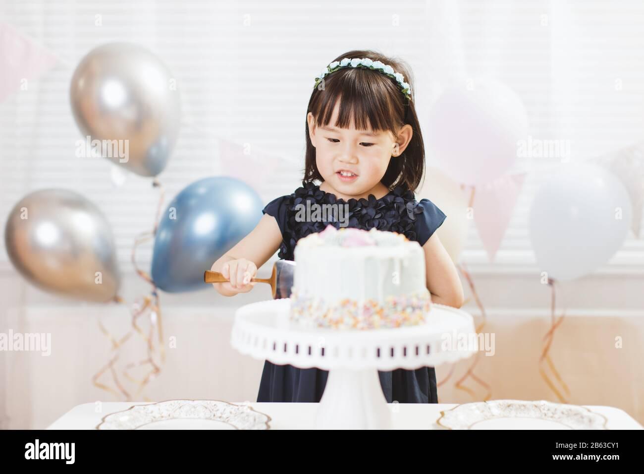Fabulous Toddler Girl Cut Birthday Cake Celebrating Her Birthday At Home Birthday Cards Printable Benkemecafe Filternl