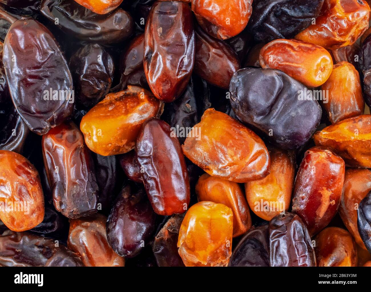 Date fruits close-up. Dried dates with different varieties. Stock Photo