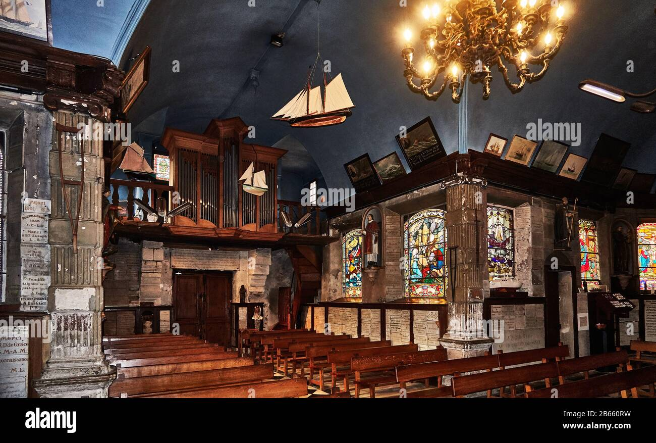 interior of Our Lady of Grace Chapel Built during the 17th century, this chapel is richly adorned with paintings and models of ships offered ex voto by sailors , France, Calvados , Basse-Normandie , Catholic chapel located in Équemauville Stock Photo
