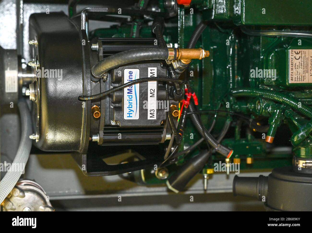 Looking down into the engine bay at a new Hybrid Marine unit fitted to a new diesel engine fitted in a narrowboat on the UK waterways. Stock Photo