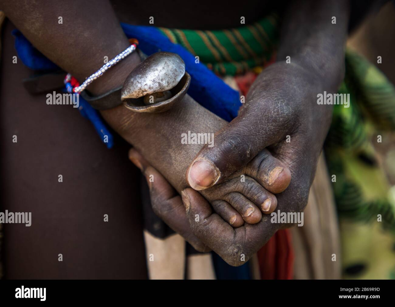 Larim Tribe Mother Hand Touching The Foot Of Her Baby Boya