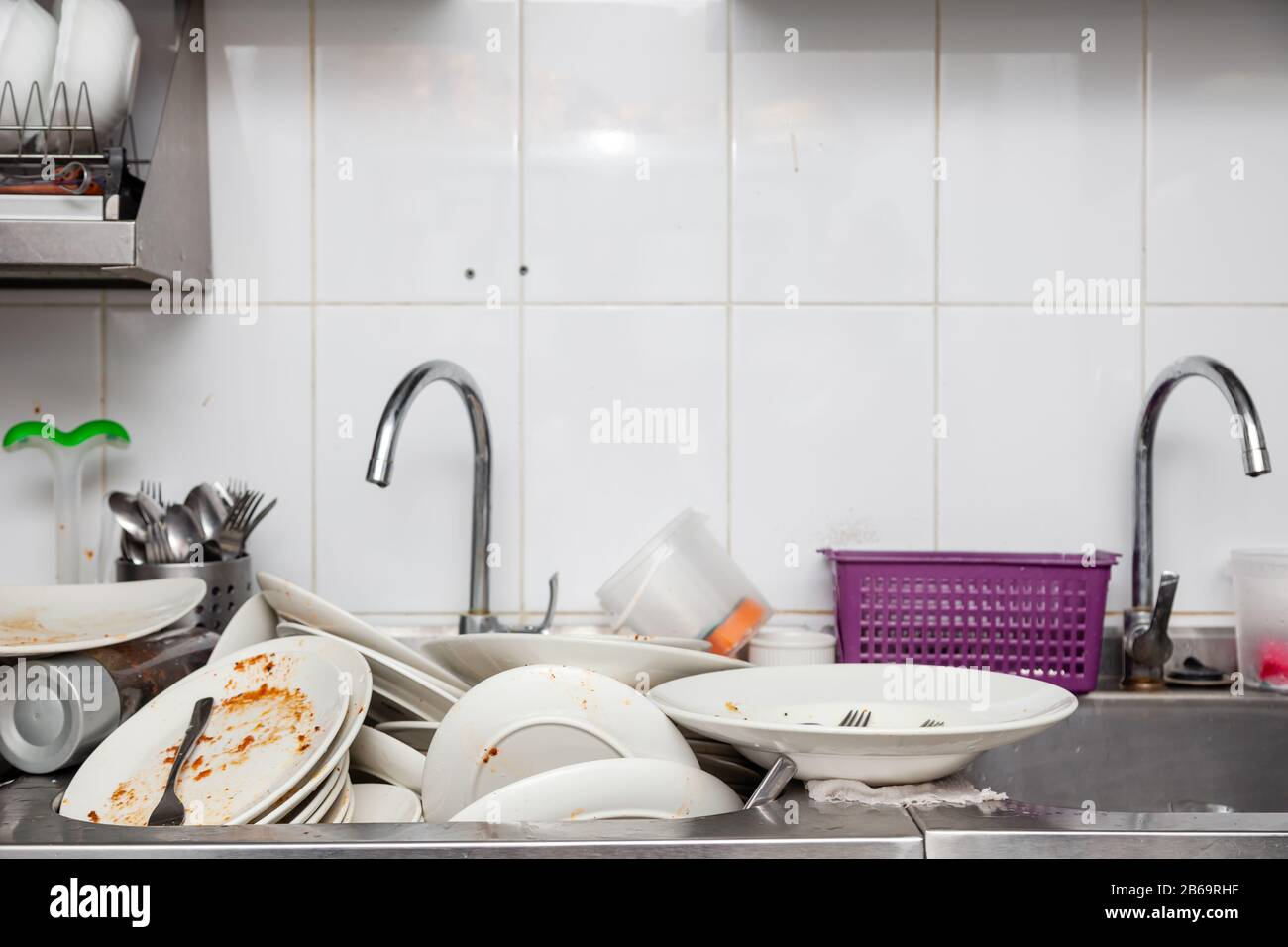 Large Metal Sink With Dirty Dishes In Professional Restaurant Kitchen Stack Of Messy White Plates Crockery Appliances With Leftover Food Water Tap Stock Photo Alamy