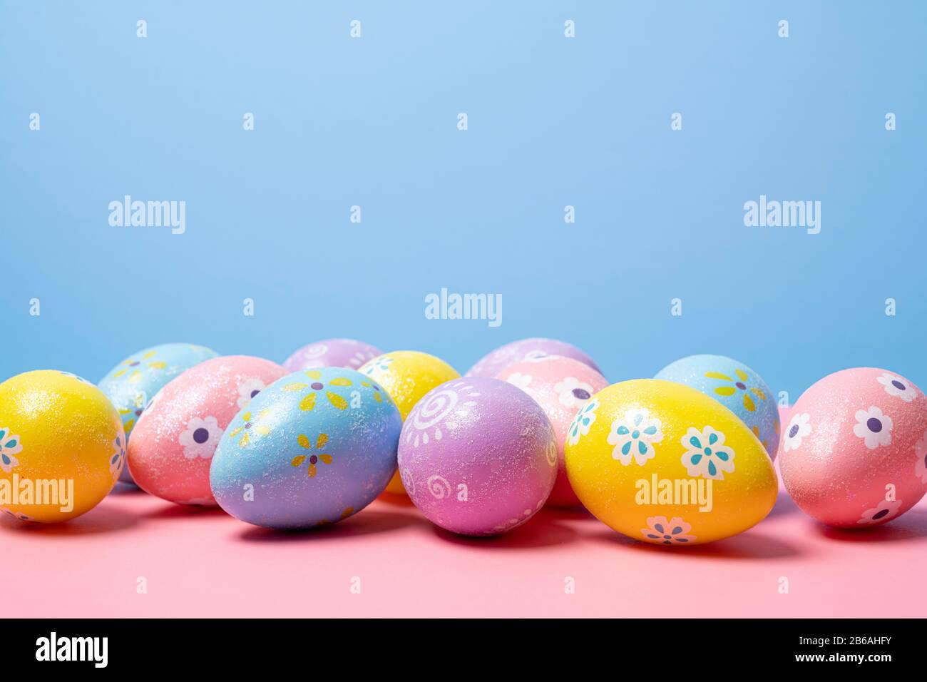 Painted Easter eggs on a colorful background Stock Photo