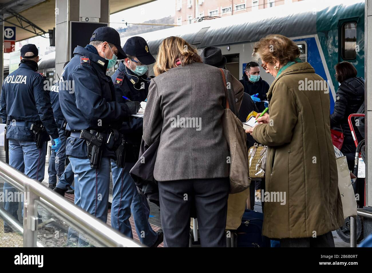 Turin, Italy. 09th Mar, 2020. TURIN, ITALY - March 09, 2020: Police officers check passengers leaving from Turin Porta Nuova train station. The Italian government imposed a virtual lockdown on the north of the country as part of measures to stop the spread of the coronavirus COVID-19 outbreak in Italy. (Photo by Nicolò Campo/Sipa USA) Credit: Sipa USA/Alamy Live News Stock Photo