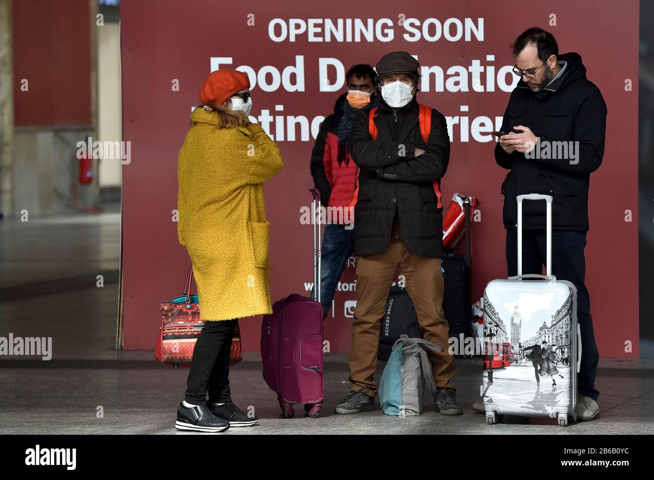 Turin, Italy. 09th Mar, 2020. TURIN, ITALY - March 09, 2020: Passengers with their bags wait in Turin Porta Nuova train station. The Italian government imposed a virtual lockdown on the north of the country as part of measures to stop the spread of the coronavirus COVID-19 outbreak in Italy. (Photo by Nicolò Campo/Sipa USA) Credit: Sipa USA/Alamy Live News Stock Photo