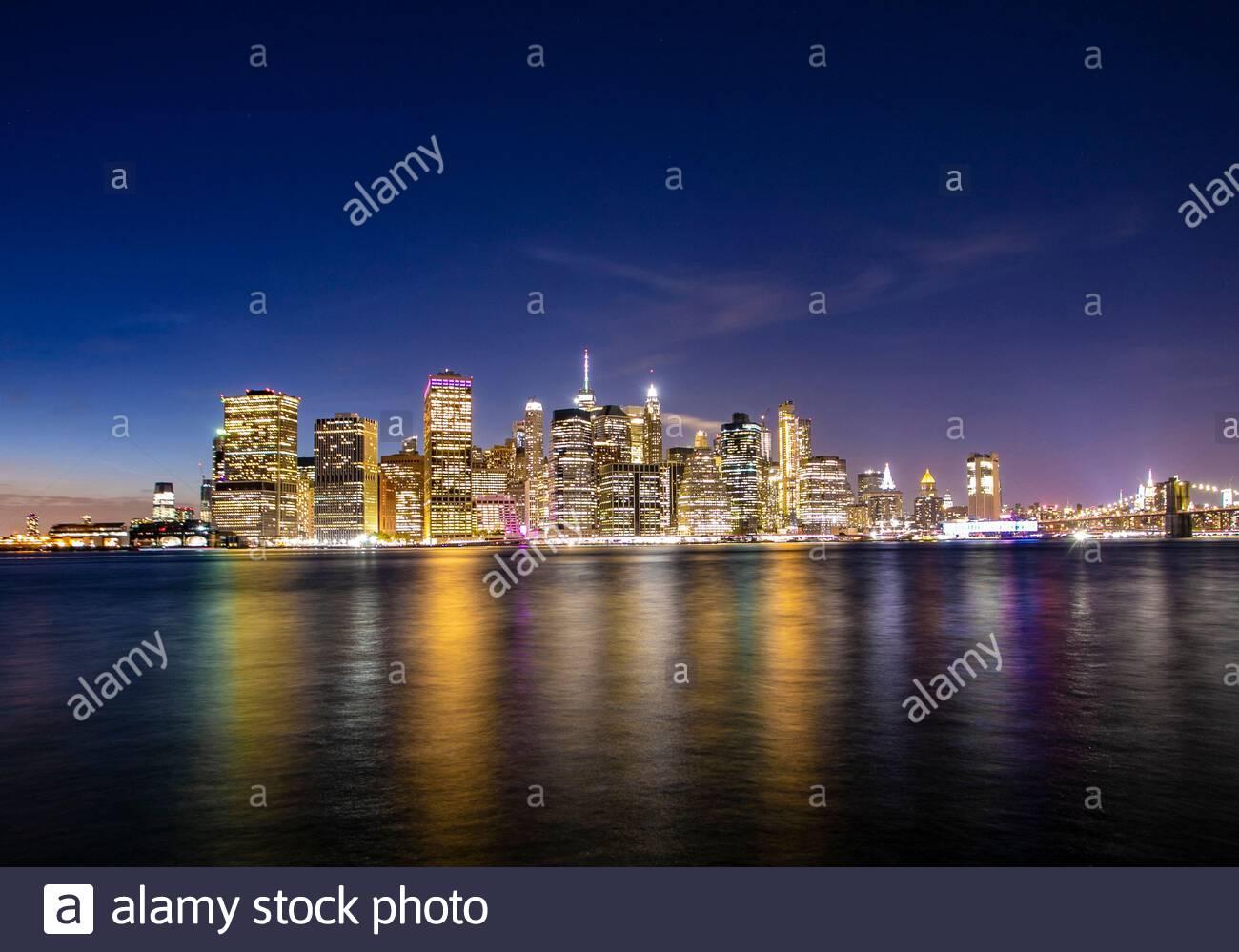 New York City, Lower Manhattan, view from Brooklyn Bridge Park at sunset Stock Photo