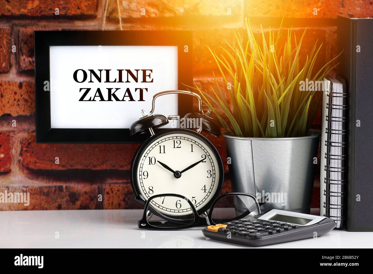 zakat high resolution stock photography and images alamy https www alamy com online zakat text with alarm clock books and vase on brick background business quotes and copy space concept image348140771 html