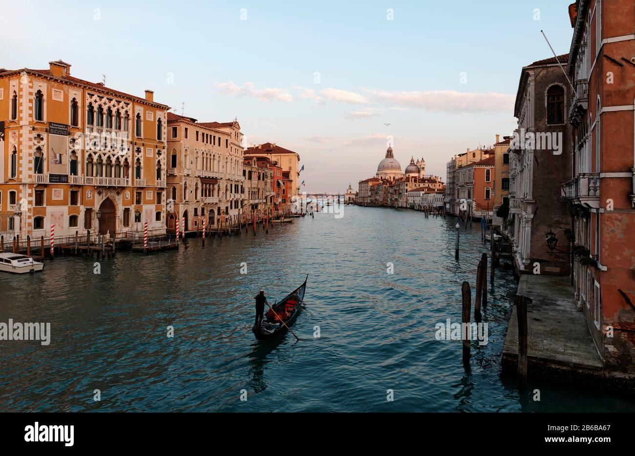 VENICE, ITALY - February 19, 2020 :Picturesque view of Gondolas on Canal Grande with Basilica di Santa Maria della Salute in the background Stock Photo