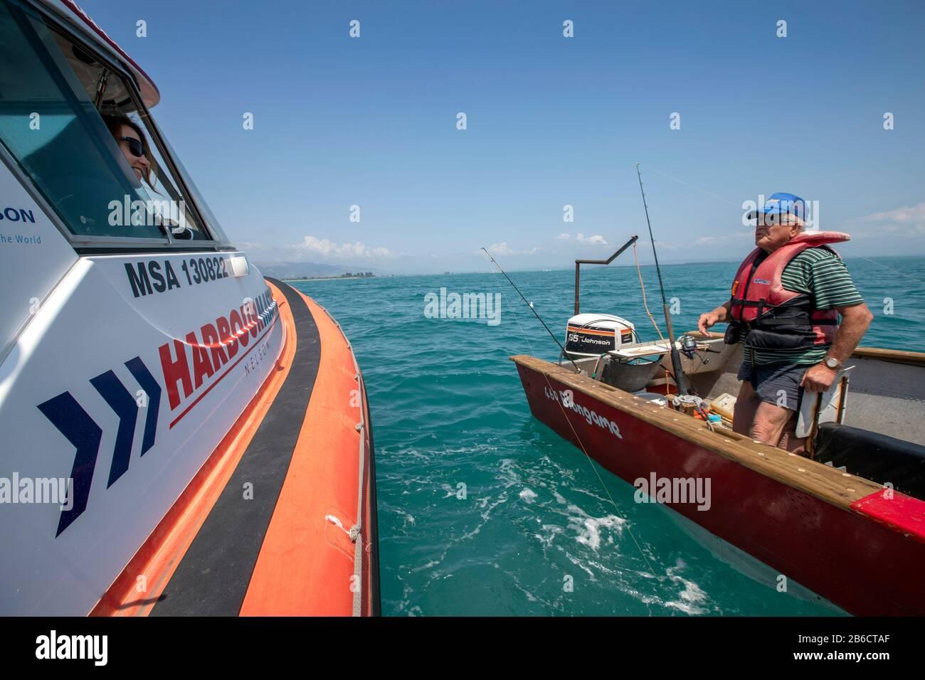 Port Nelson deputy harbourmaster Amanda Kerr on the waters off Port Nelson, Nelson, New Zealand Stock Photo