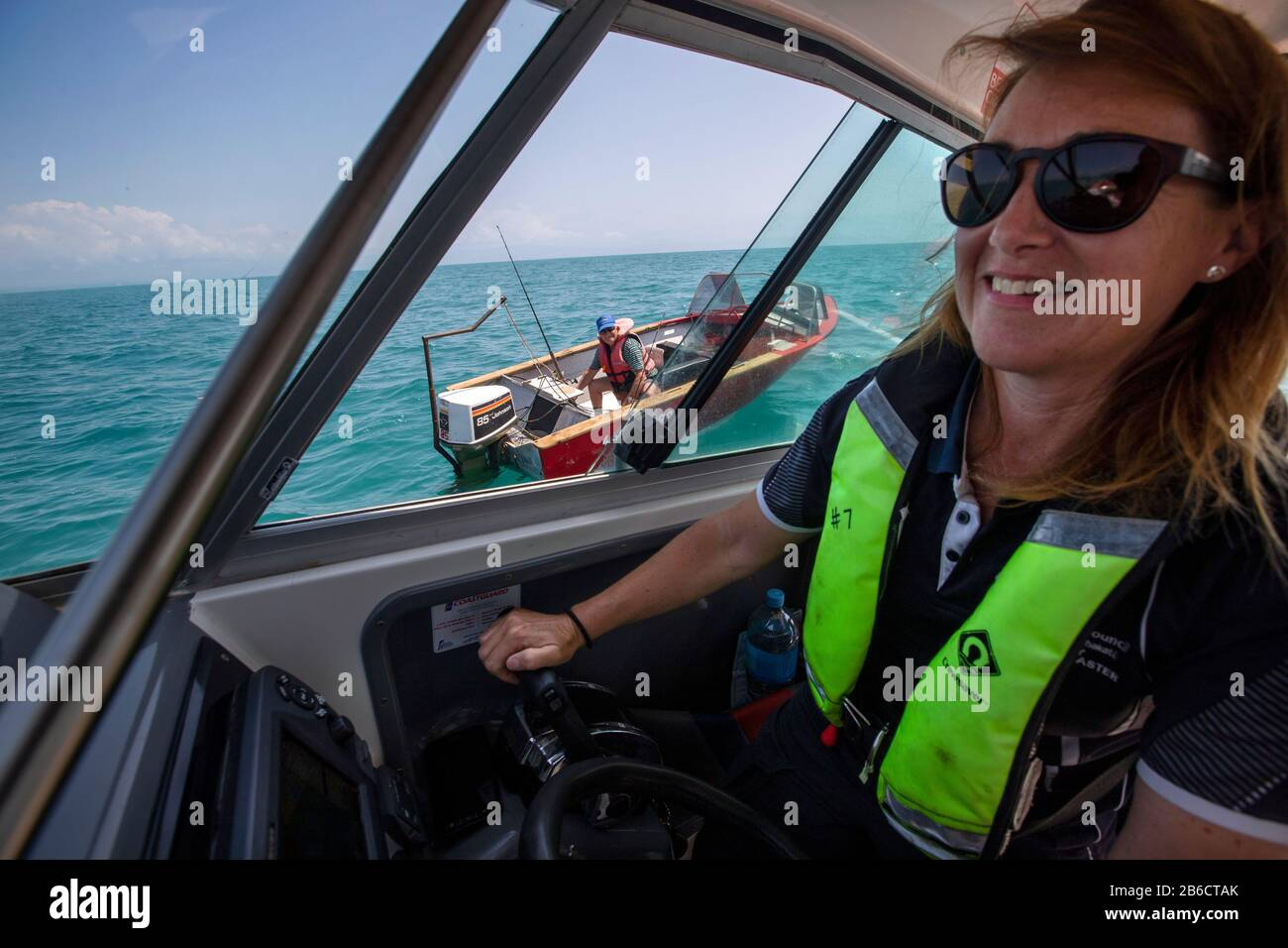 Port Nelson deputy harbourmaster Amanda Kerr on the waters off Port Nelson, Nelson, New Zealand Stock Photo