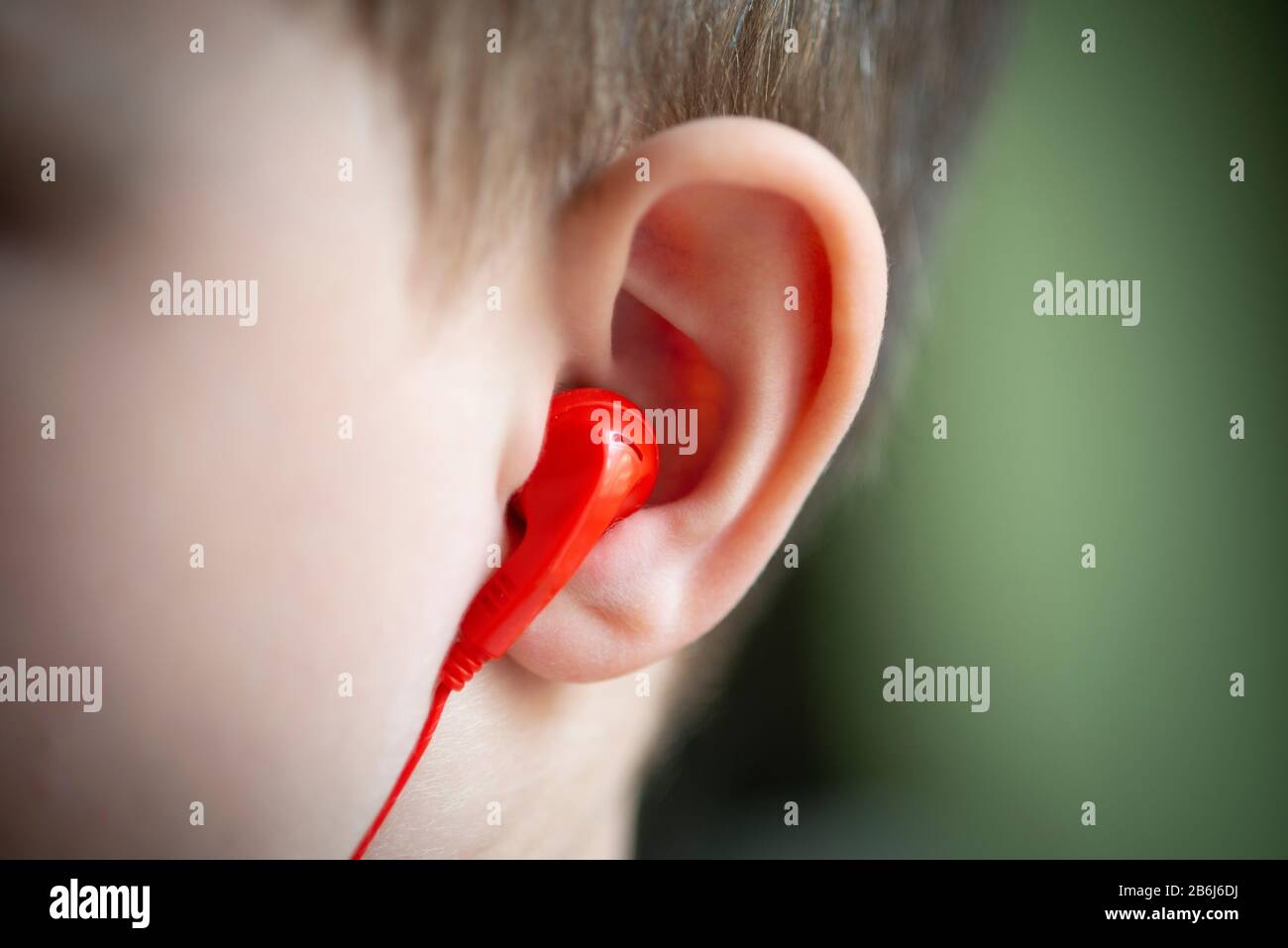 Little Boy and Ear Phones Stock Photo