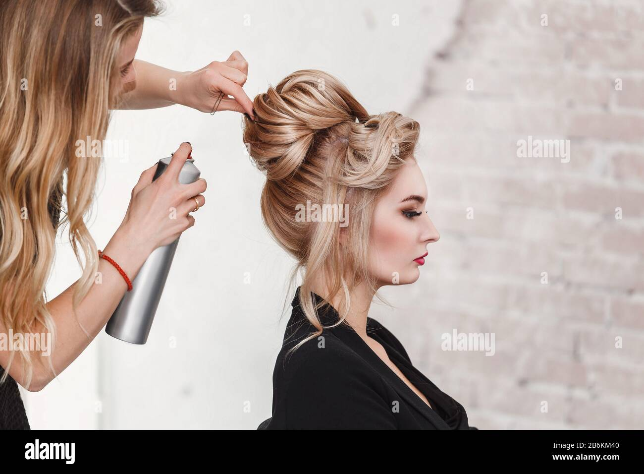 Professional Hairdresser Using Hair Spray On Client Business Woman Hair At Beauty Salon Stock Photo Alamy