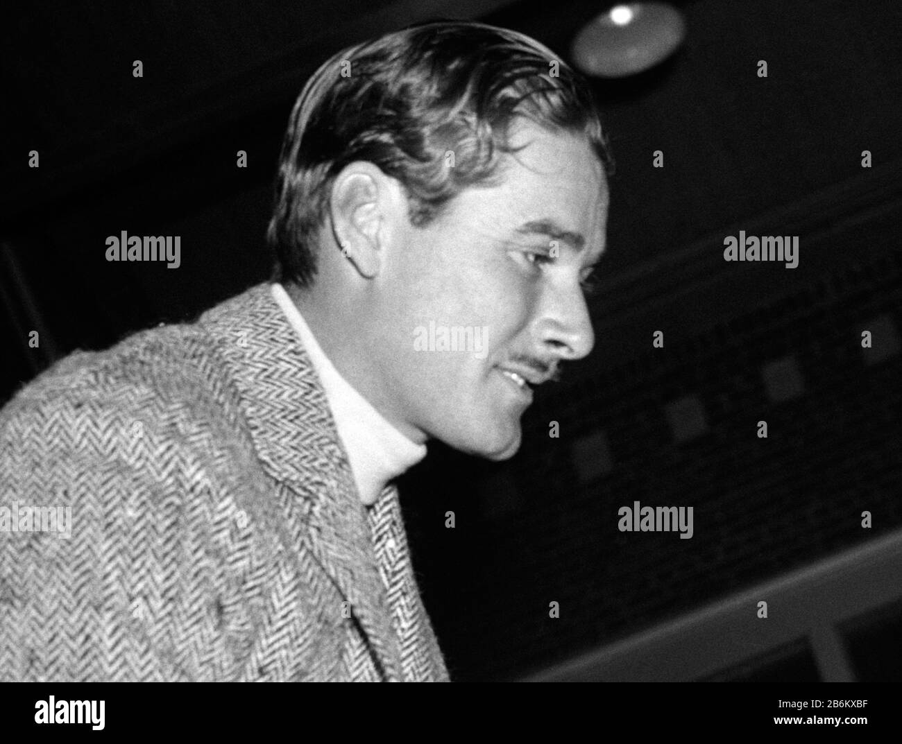 Vintage photo of Australian-born movie star Errol Flynn (1909 – 1959). The photo by Harris & Ewing was taken on January 25 1939 at a horseshow held at Fort Myer, Virginia, as part of birthday celebrations for President Franklin D Roosevelt. Stock Photo