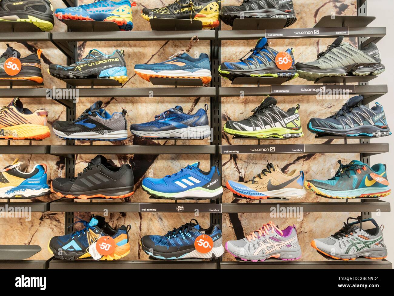 Trail running shoes store display Stock